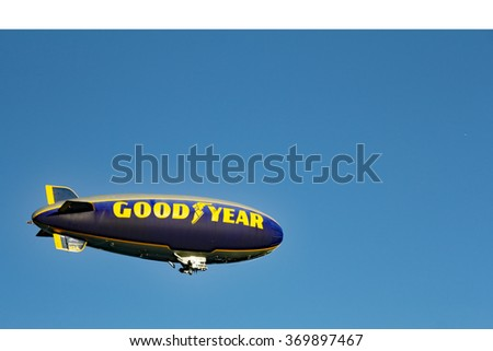 Hollywood, FL, USA - December 14, 2014: One Goodyear blimp flying in the sky in Hollywood, Florida. An airship in the sky with the words Good Year written on its side. - stock photo
