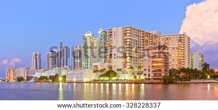 Hollywood Florida, buildings at sunset reflected in the water - stock photo