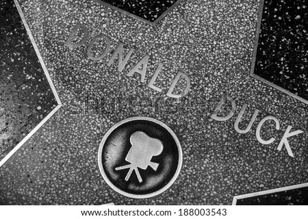 HOLLYWOOD - JANUARY 3: Donald Duck's star on Hollywood Walk of Fame on January 3, 2014 in Hollywood, California. This star is located on Hollywood Blvd. and is one of 2400 celebrity stars. - stock photo