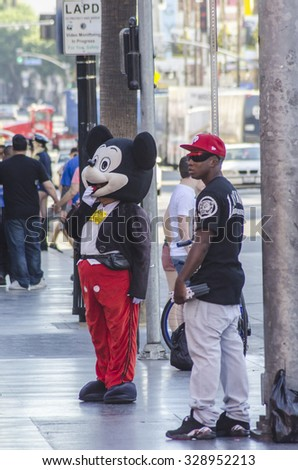 Hollywood, Los Angeles, California, USA - November 6, 2013: Man dressed as Mickey Mouse at Hollywood Boulevard. - stock photo