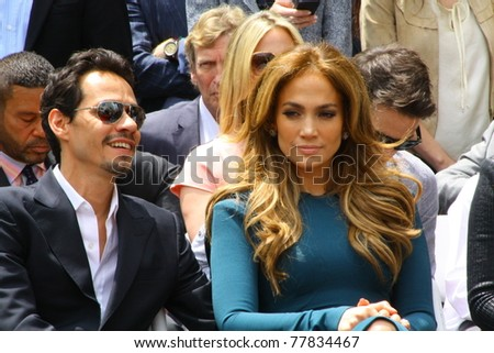 HOLLYWOOD - MAY 23: American Idol judge Jennifer Lopez and husband Marc Anthony at the Hollywood Walk of Fame ceremony for American Idol producer Simon Fuller on May 23, 2011 in Hollywood, CA. - stock photo