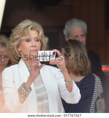 HOLLYWOOD - MAY 5: Jane Fonda is taking photo of crowd while Sally Field's star celebration on 5 May in 2014 at the Walk of Fame in Hollywood - stock photo