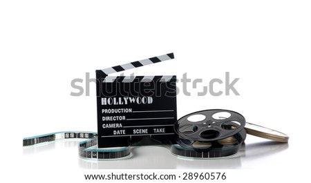 Hollywood movie items on a white background, including a movie clapboard, film reel, film containers or tins and film - stock photo