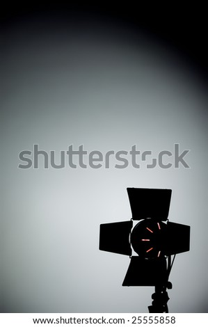 Hollywood movie light with barn doors in the corner and shadows - stock photo