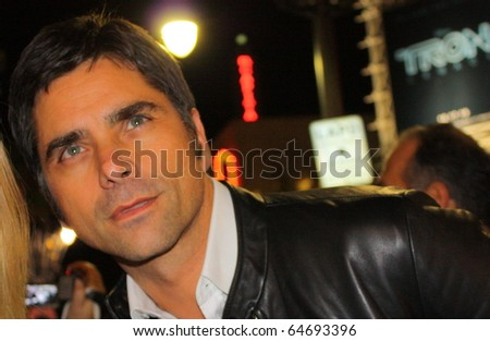 HOLLYWOOD - NOVEMBER 8: Actor John Stamos at the showing of the film Casino Jack during the AFI FEST at Grauman's Chinese Theatre November 8, 2010 in Hollywood, CA. - stock photo