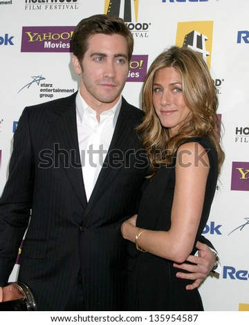 HOLLYWOOD - OCTOBER 24: Jake Gyllenhaal Jennifer Aniston participate at Hollywood Film Festival Gala in Beverly Hilton Hotel October 24, 2005 in Los Angeles, CA. - stock photo