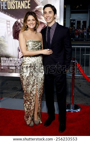 """HOLLYWOOD, USA - AUGUST 23: Drew Barrymore and Justin Long at the Los Angeles Premiere of """"Going The Distance"""" held at the Grauman's Chinese Theatre in Los Angeles, USA on August 23, 2010. - stock photo"""