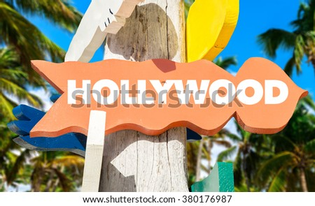 Hollywood welcome sign with palm trees - stock photo