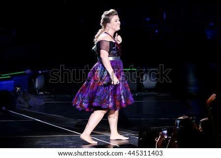 HOLMDEL, NJ-JUL 14: Recording artist Kelly Clarkson performs during her 'Piece by Piece' Tour at PNC Bank Arts Center on July 14, 2015 in Holmdel, New Jersey. - stock photo