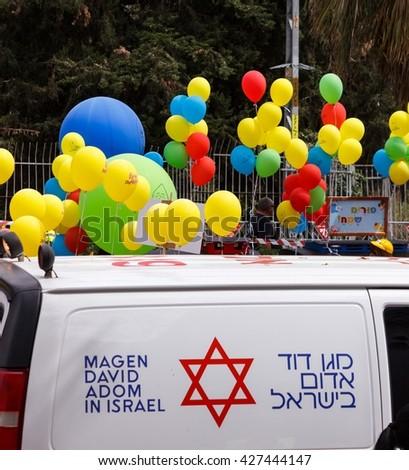 HOLON, ISRAEL - MARCH 2016: Ambulance on duty durring Adloyada (purim celebration parade) - stock photo