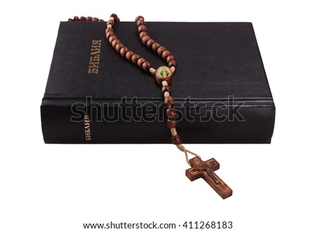 Holy Bible and cross on isolated background - stock photo