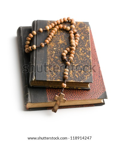holy bible and rosary beads on white background - stock photo