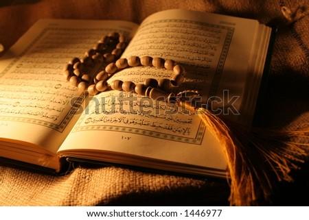 holy book & rosary    - stock photo