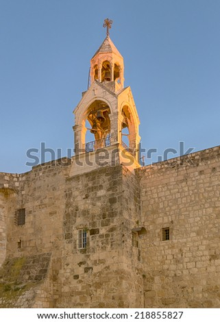 Holy Church Of The Nativity bell tower glows in the late afternoon sun, Bethlehem, Israel.  The church marks the spot where Jesus was born (Luke 2:7). - stock photo