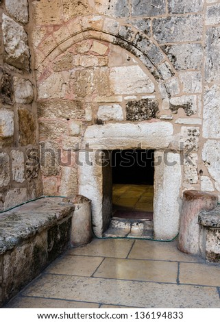 Holy Church Of The Nativity, Bethlehem, Israel - The Church of the Nativity was built over the spot where Jesus was born (Luke 2:7). The door was reduced in size as a defense against hostile forces. - stock photo