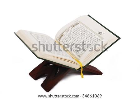 Holy islamic book Koran opened and isolated - stock photo