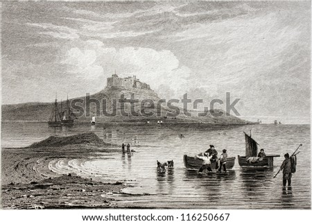 HOLY ISLAND CASTLE in Northumberland, England on ancient engraving from 1824. Drawn and Engraved by W. Woolnoth. Published in London by Longman in May 1824. - stock photo