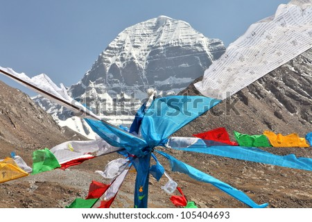 Holy Mount Kailash in Tibet and Buddhist prayer flags on foreground - stock photo