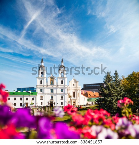Holy Spirit Cathedral. Minsk, Belarus. View of Orthodox Church in Historical Center Nemiga. Defocused Flowers on the Foreground.  - stock photo