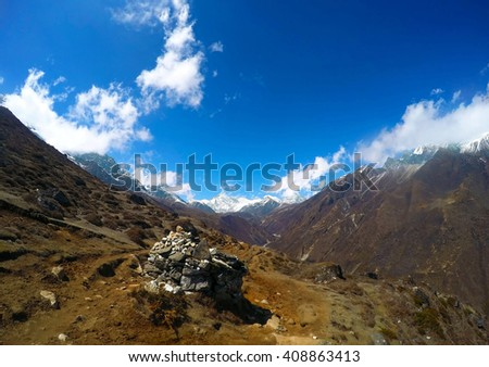 Holy stones in the mountains, Himalaya mountains, ideal landscape with blue sky and mountains, trek to Everest base camp, Nepal mountains, mountain landscape, summer in mountains, summer in Himalaya - stock photo