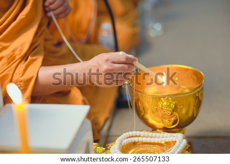 Holy water, the monks and religious rituals in thai ceremony. Wedding thai style - stock photo