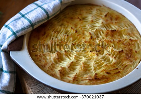 homade Shepherd's Pie in the casserole dish. - stock photo