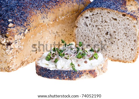 Home a loaf of rye bread with seeds and poppy seeds - stock photo