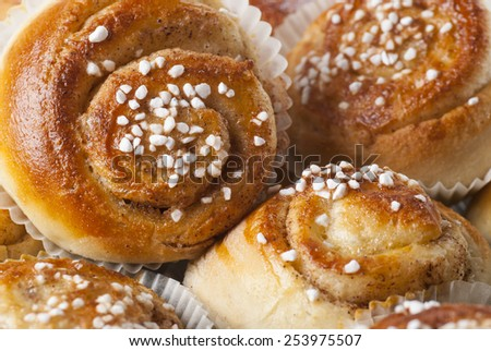 Home baked cinnamon buns. New version. - stock photo