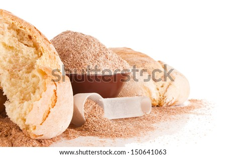 home baked goods with brans and measure spoon isolated on white background - stock photo