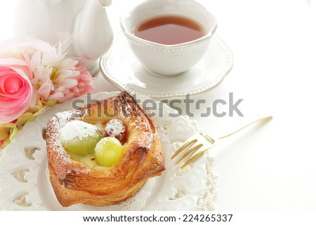 home bakery, autumn grape on Danish pastry with tea on background, - stock photo