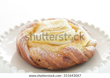 Home bakery pear and custard cream on Danish pastry for gourmet autumn dessert image - stock photo