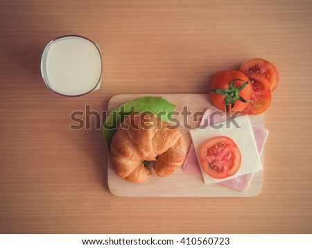 Home breakfast ,Croissant ham cheese with milk - stock photo