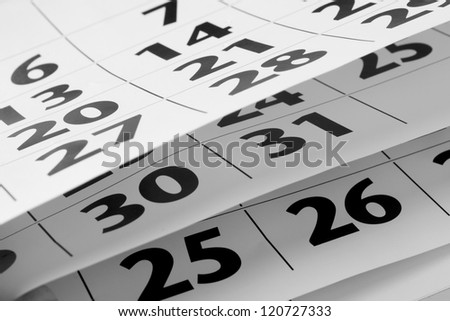 home calendar with dates and yellow sharpened pencil - stock photo