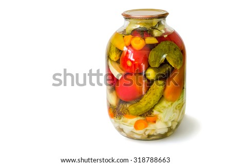 Home canning: a small glass cylinder with a variety of canned vegetables, sealed metal lid. Presented on a white background.. - stock photo