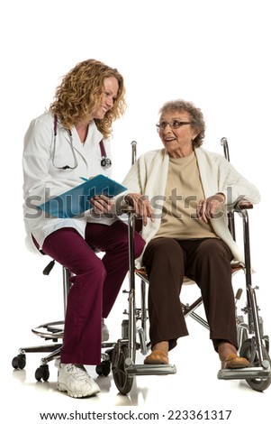 Home Care Nurse Checking with Senior on Wheelchair on Isolated White Background - stock photo