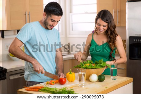 Home chefs prepare a happy healthy nutrition based low calorie meal - stock photo