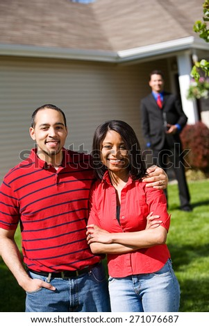Home: Couple Ready to Work with Real Estate Agent - stock photo