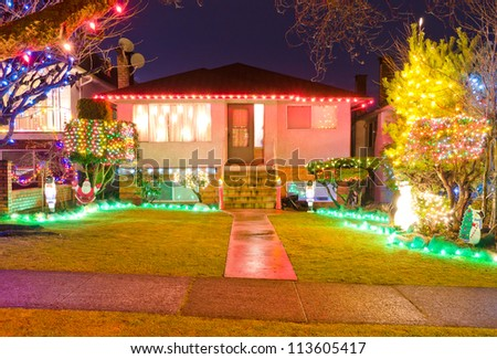 Home decorated and lighted for Christmas and for New Year Eve at Night in Vancouver, Canada. - stock photo