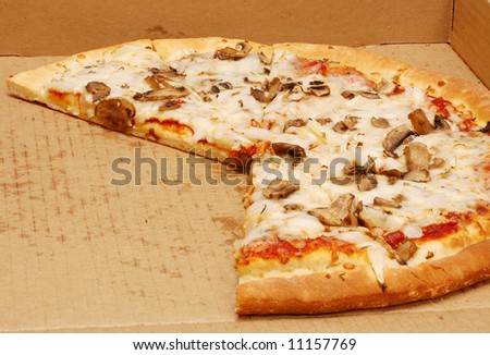 Home delivered pizza in a box with slices missing - stock photo