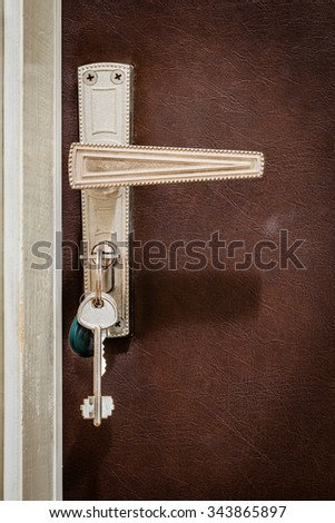 Home door. Keys are inserted in the lock of the entrance door of the apartment. - stock photo
