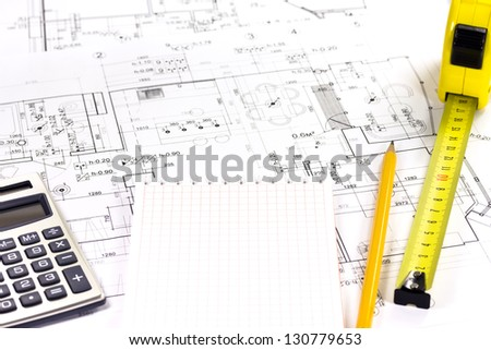 Home extension blueprint plan and tools - stock photo