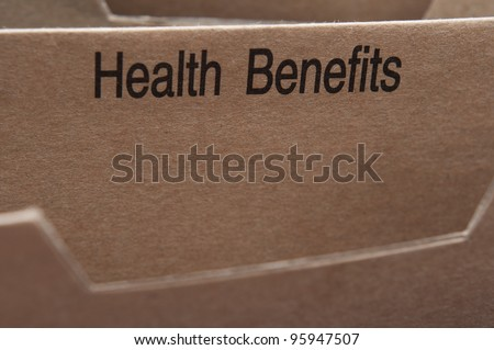 Home filing for health benefits care and insurance documents. - stock photo