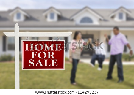 Home For Sale Real Estate Sign and Playful Hispanic Family in Front of House. - stock photo
