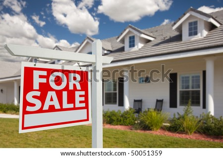 Home For Sale Real Estate Sign in Front of New House - Left Facing. - stock photo