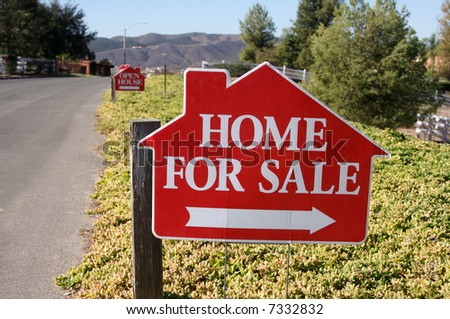 Home For Sale Sign along a rural street. - stock photo