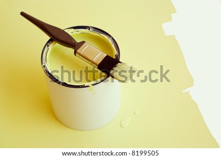 Home improvement paint brush on paint tin - stock photo