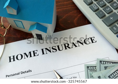 Home insurance form and dollars on the table. - stock photo
