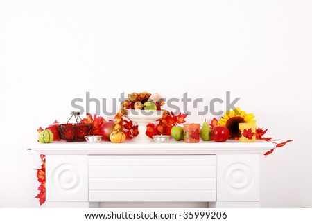 Home interior - decoration of sideboard for Thanksgiving with copyspace - stock photo