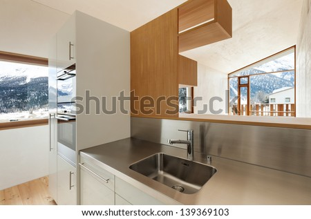 home interior with concrete walls, view from the kitchen - stock photo
