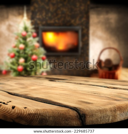 home interior with worn old table fireplace and tree of green space  - stock photo